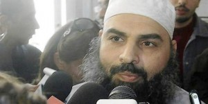 Egyptian cleric Abu Omar speaks to the media at a court house in Alexandria