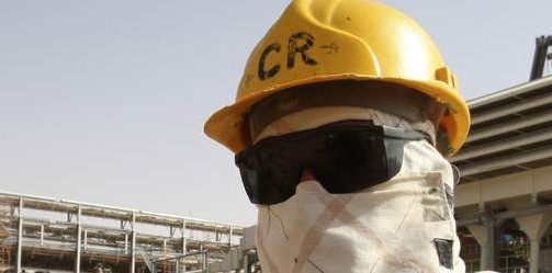 A worker looks on during a tour in the Khurais oilfield
