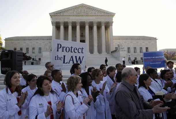 Medical students show their support for Obama's healthcare law in Washington