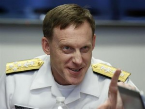NSA Director Adm. Michael Rogers answers question at Reuters CyberSecurity Summit in Washington