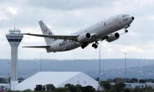 A U.S. Navy P-8 Poseidon aircraft takes off from Perth International Airport to participate in the search for the missing Malaysian Airlines flight MH370